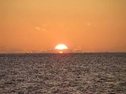 Sun Setting into sea at