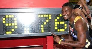 Gatlin guns down 100m record
