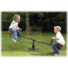 Two kids on a seesaw