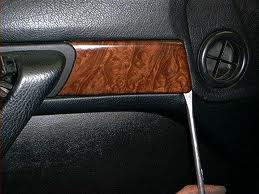 Pry the small wood trim at the
