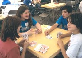 young people playing cards at
