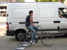 his bicycle in Amsterdam.